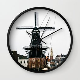 Iconic mill and church in winter, photographed through the mast of a boat | Haarlem historical city, the Netherlands | Urban travel photography Art Print Wall Clock