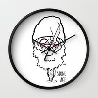 queens of the stone age Wall Clocks featuring Stone Age by LSG Designs