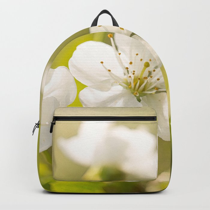 Beautiful cherry blossom on a vivid green background - summer atmosphere Backpack