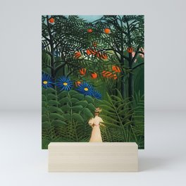 'Woman walking amid Tropical Blue Cornflowers in an exotic forest' by Henry Rousseau Mini Art Print