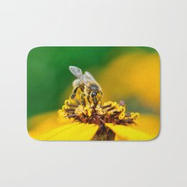 A bee on the flower Bath Mat