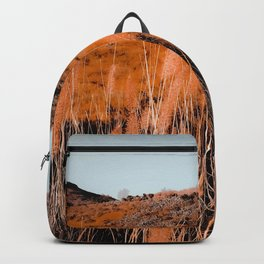 Closeup blooming grass flowers field with blue sky background Backpack
