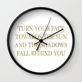Turn your face towards the sun and the shadows fall behind you~ Quote Wall Clock