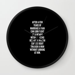 After a few years of marriage a man can look right at a woman without seeing her and a woman can see right through a man without looking at him Wall Clock