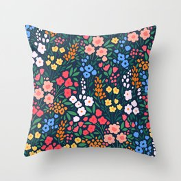 Vintage floral background. Flowers pattern with small colorful flowers on a dark blue background.  Throw Pillow