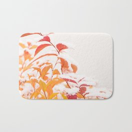 Snow covered red leaves Bath Mat