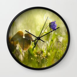 Beautiful spring - first flower little anemone with beautiful bokeh in green background Wall Clock