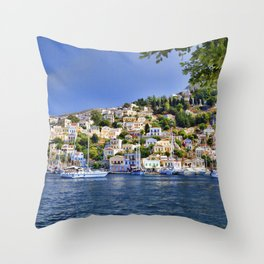Symi island in Greece. Traditional houses. Sunny day with blue sky and sea. Throw Pillow