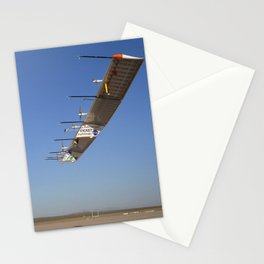 972. The Atmospheric Turbulence Measurement System booms extend forward from the Pathfinder-Plus solar wing as it soars over Rogers Dry Lake. Stationery Cards