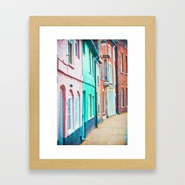 A row of colourful town houses in England Framed Art Print