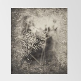 Beautiful thistle growing wild and sepia texture Throw Blanket
