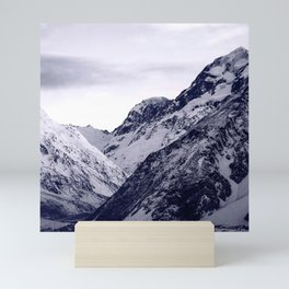 Snow-Covered Rocky Mountains Covered By Moody Sky Mini Art Print