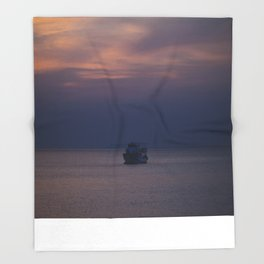 Boat at sunset Throw Blanket