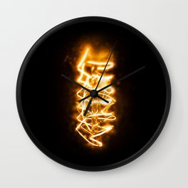 The electric filament of a light bulb, orange/yellow glow II | Color Photography | Macro Photography | Photo Print | Art Print Wall Clock