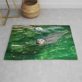 Seals Swimming In Emerald Waters Rug
