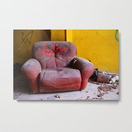 old red armchair abandoned in a disused warehouse Metal Print