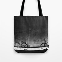 bicycles Tote Bags featuring Bicycles by Tomas Hudolin