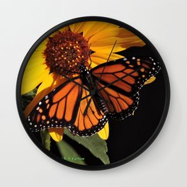 Monarch on a Desert Sunflower Wall Clock