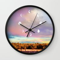 moon phases Wall Clocks featuring Moon Phases by LoveFreeMovement