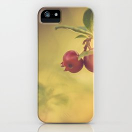 Macro shot of cowberry growing in forest iPhone Case