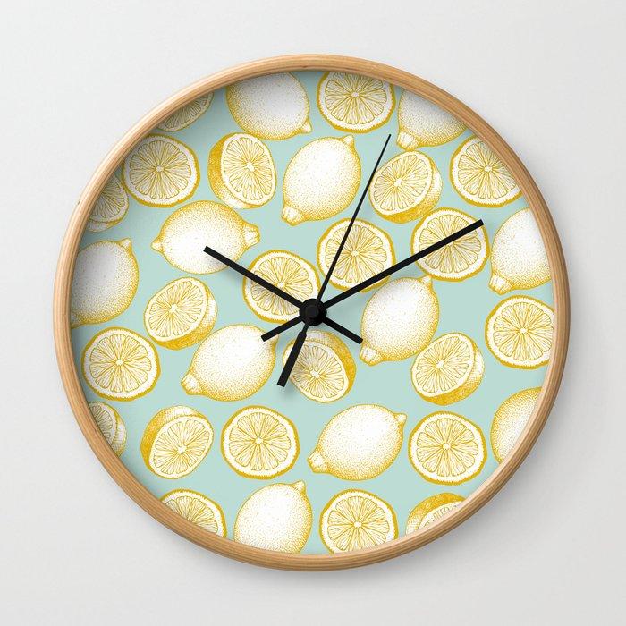 Lemons On Turquoise Background Wall Clock