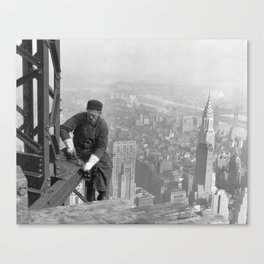 A construction worker on top of the Empire State Building in 1930, New York. Canvas Print