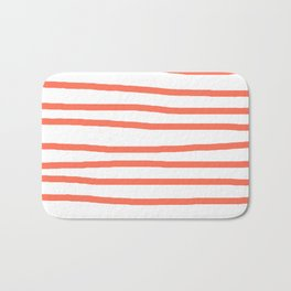 Simply Drawn Stripes in Deep Coral Bath Mat