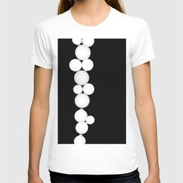 Isolated picture of white round lamps on the black wall. T-shirt