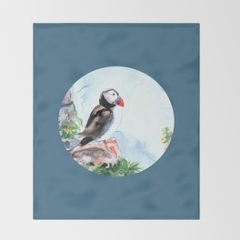 Puffin sitting on a rock with a blue background Throw Blanket