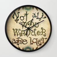 not all who wander are lost Wall Clocks featuring Not All Who Wander by Jenndalyn