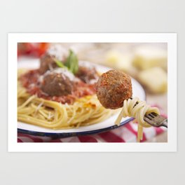 Spaghetti and meatball on a fork, plate in the background Art Print