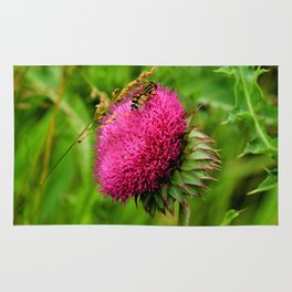 The thistle and a fly Rug
