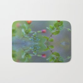 Reflection of little red wildflowers Bath Mat