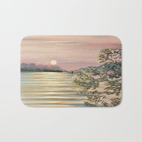 Sunset over a lake Bath Mat