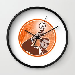 Businessman Holding Lightbulb Woodcut Wall Clock