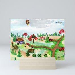 A Scarecrow in the Garden Mini Art Print