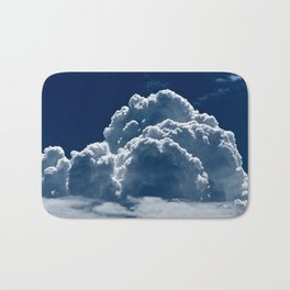 Puffy Cumulus clouds on Deep Blue Sky Bath Mat