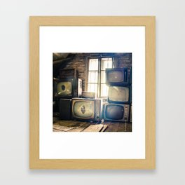 Old televisions in a dusty attic Framed Art Print
