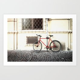 Bicycle standing on old street Art Print