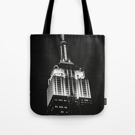 Dramatic Empire State Building in New York City at night Tote Bag