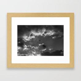 Plane and storm Framed Art Print