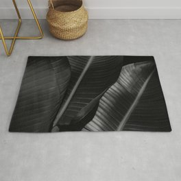 Banana leaf allure - night Rug