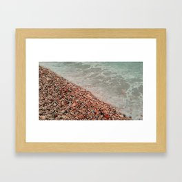 sea waves lapping on the beach of pebbles. Framed Art Print