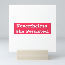 Never the Less, She persisted. In white on red Mini Art Print