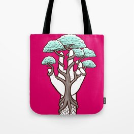 Tree growing within a hand – interlacing of nature and humanity Tote Bag