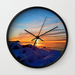 Sun sets on frozen land Wall Clock