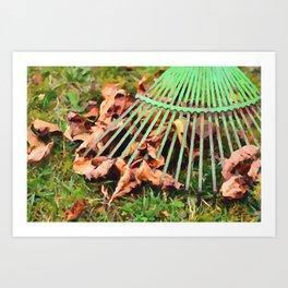 Raking the fallen autumn leaves Art Print