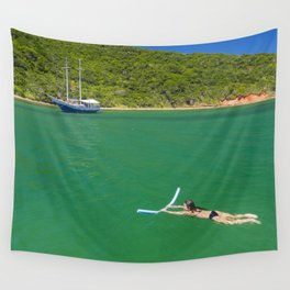 Woman swimming in green waters in Brazil Wall Tapestry