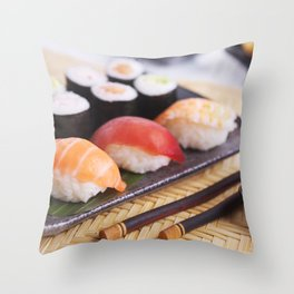 Shrimp tempura and various Japanese sushi on a plate Throw Pillow