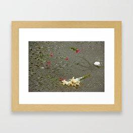 Flowers in a frozen pond Framed Art Print
